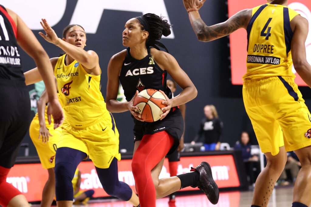 PALMETTO, FL - SEPTEMBER 8: A'ja Wilson #22 of the Las Vegas Aces drives to the basket against the Indiana Fever on September 8, 2020 at Feld Entertainment Center in Palmetto, Florida. NOTE TO USER: User expressly acknowledges and agrees that, by downloading and/or using this Photograph, user is consenting to the terms and conditions of the Getty Images License Agreement. Mandatory Copyright Notice: Copyright 2020 NBAE (Photo by Ned Dishman/NBAE via Getty Images)