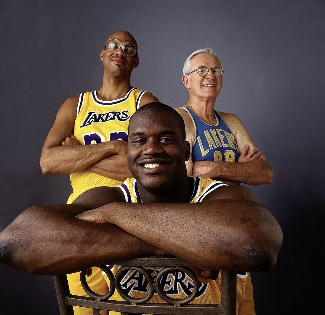 LOS ANGELES - 1996: Shaquille O'Neal #34, Kareem Abdul Jabbar #33 and George Mikan #88, three generations of great Los Angeles Lakers centers pose for a portrait in Los Angeles, California. NOTE TO USER: User expressly acknowledges and agrees that, by downloading and/or using this Photograph, User is consenting to the terms and conditions of the Getty Images License Agreement. (Photo By Peter Read Miller/NBAE via Getty Images)