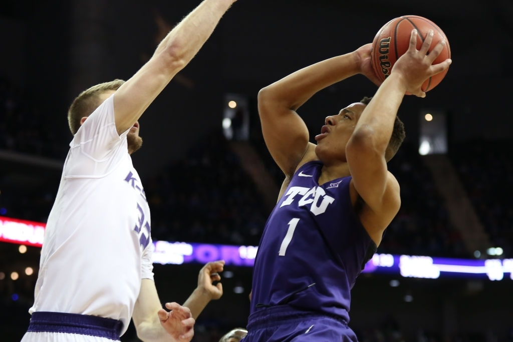 KANSAS CITY, MO - MARCH 08: TCU Horned Frogs guard Desmond Bane (1) goes to the basket against Kansas State Wildcats forward Dean Wade (32) in the second half of a quarterfinal game in the Big 12 Basketball Championship between the TCU Horned Frogs and Kansas State Wildcats on March 8, 2018 at Sprint Center in Kansas City, MO. Kansas State won 66-64 in overtime. (Photo by Scott Winters/Icon Sportswire via Getty Images)