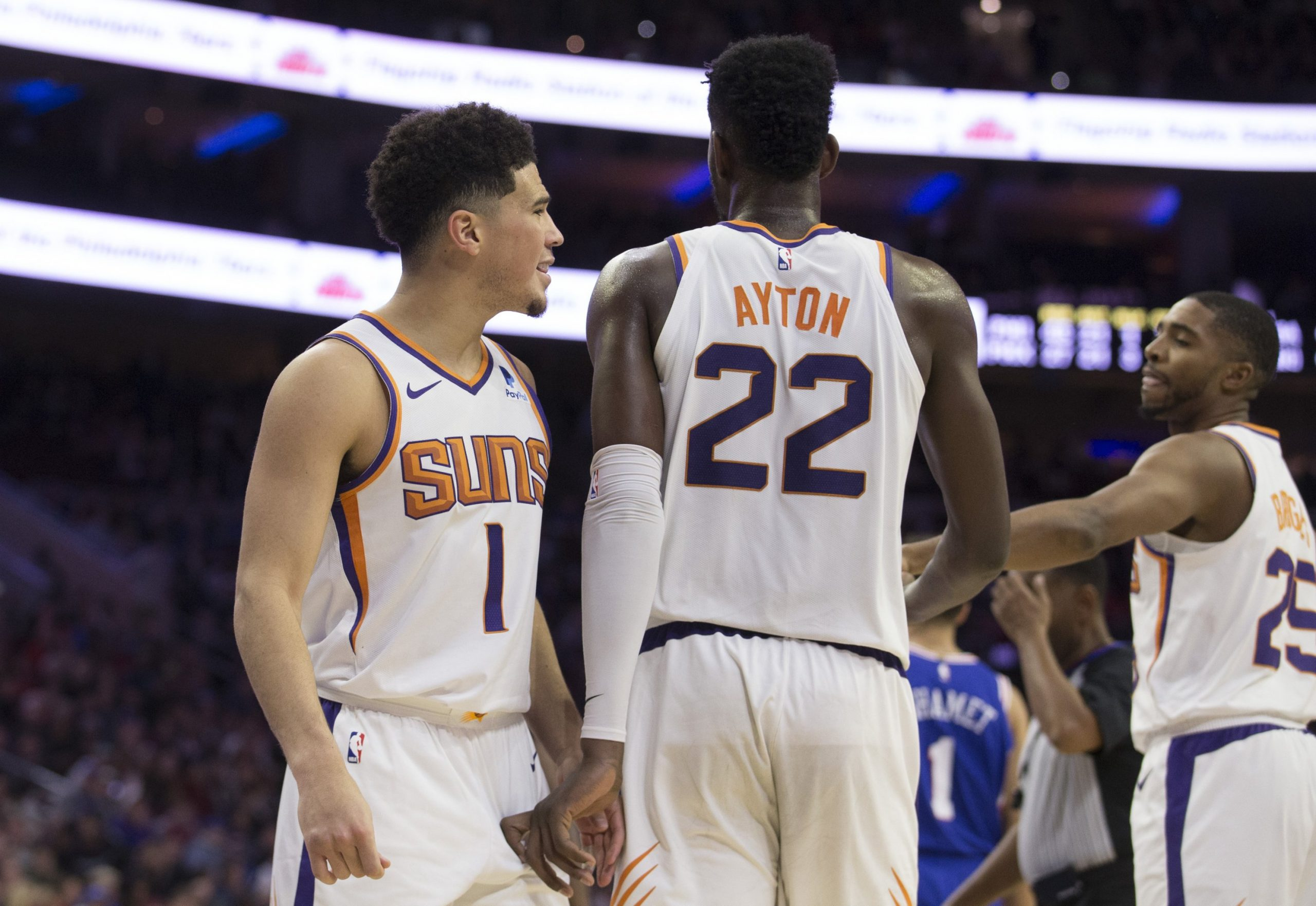 MIAMI, FLORIDA - FEBRUARY 25: Mikal Bridges #25, Deandre Ayton #22 and Kelly Oubre Jr. #3 of the Phoenix Suns huddle against the Miami Heat during the first half at American Airlines Arena on February 25, 2019 in Miami, Florida. NOTE TO USER: User expressly acknowledges and agrees that, by downloading and or using this photograph, User is consenting to the terms and conditions of the Getty Images License Agreement. (Photo by Michael Reaves/Getty Images)