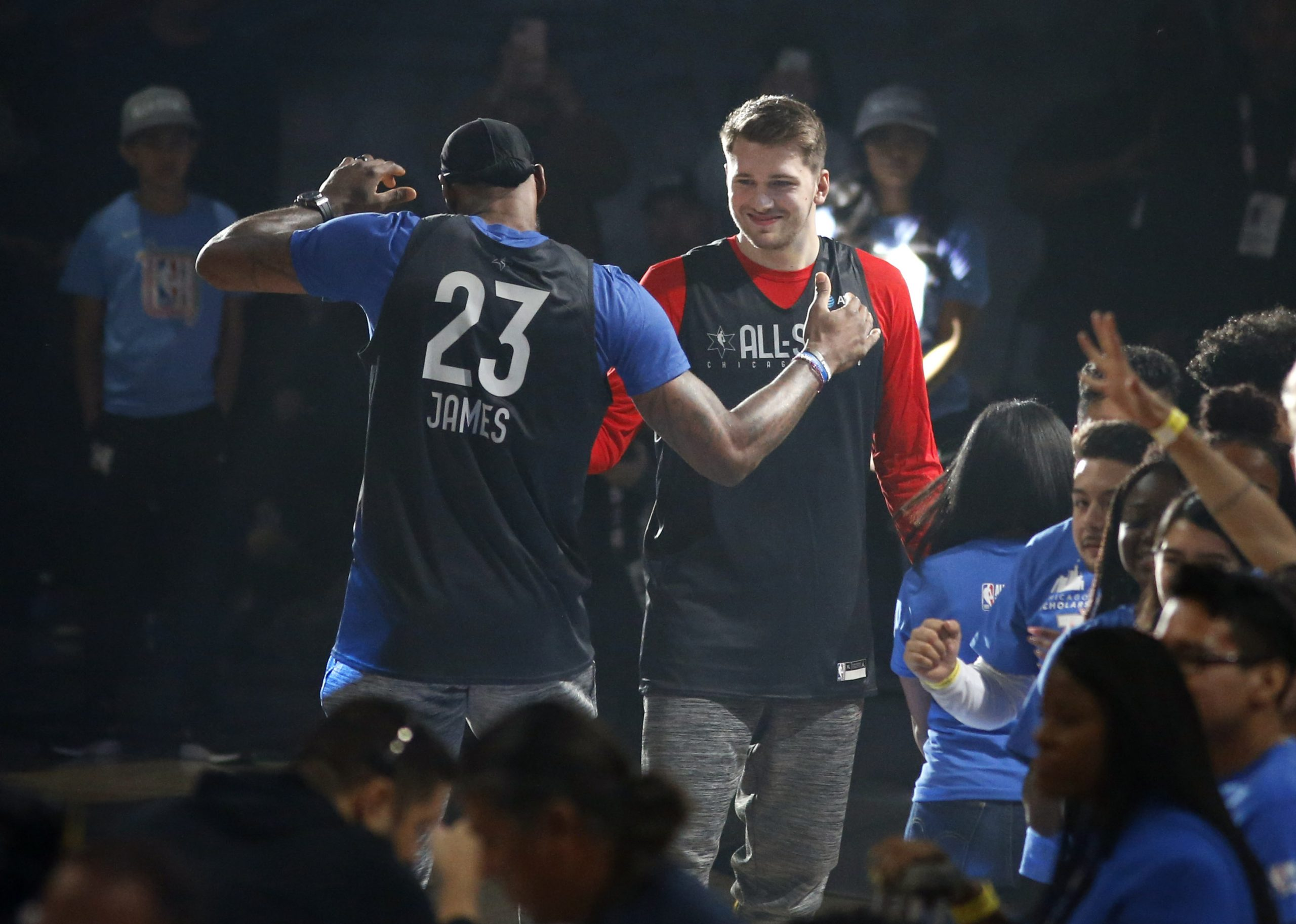 Team LeBron's Los Angeles Lakers LeBron James (23) and Dallas Mavericks forward Luka Doncic (77) meet after player introductions during practice for the NBA All-Star 2020 game at Wintrust Arena in Chicago on Saturday, February 15, 2020. (Vernon Bryant/The Dallas Morning News)