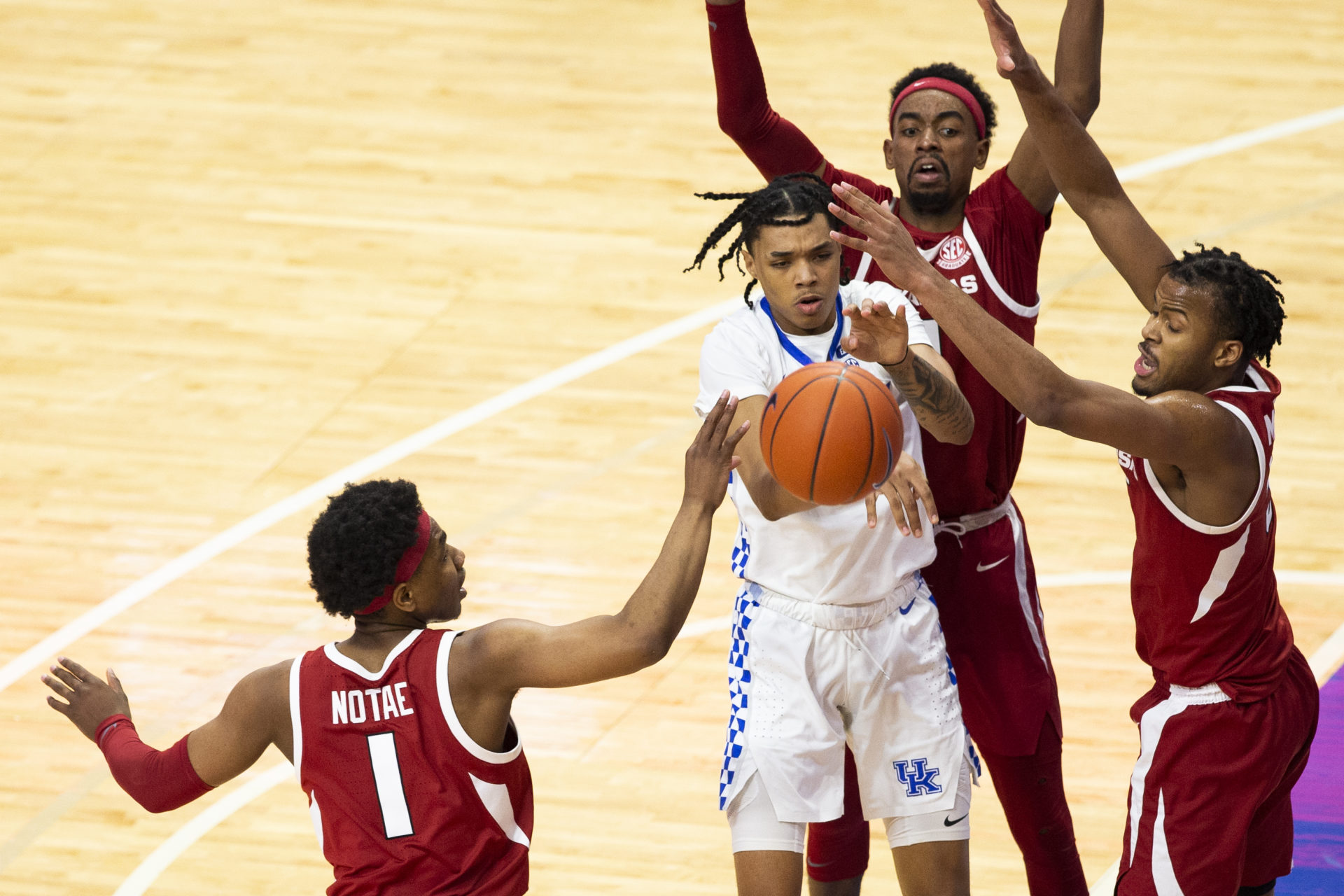 Feb 9, 2021; Lexington, Kentucky, USA; Kentucky Wildcats guard Brandon Boston Jr. (3) passes the ball while being guarded by Arkansas Razorbacks guard JD Notae (1), guard Moses Moody (5) and guard Jalen Tate (11) during the second half of the game at Rupp Arena at Central Bank Center. Mandatory Credit: Arden Barnes-USA TODAY Sports