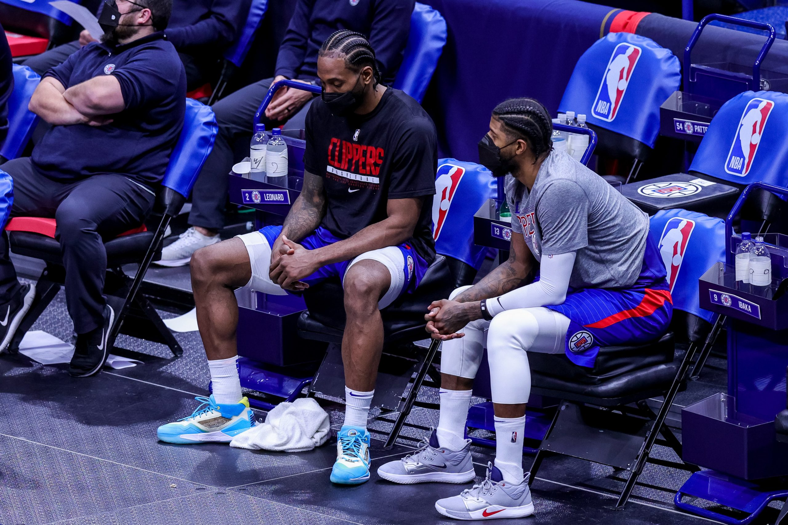 Mar 14, 2021; New Orleans, Louisiana, USA;  LA Clippers guard Paul George (13) and forward Kawhi Leonard (2) react to a play from the bench against New Orleans Pelicans during the second half at the Smoothie King Center. Mandatory Credit: Stephen Lew-USA TODAY Sports
